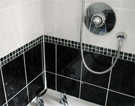photograph of bathroom tiled by Versa Tile Ceramics